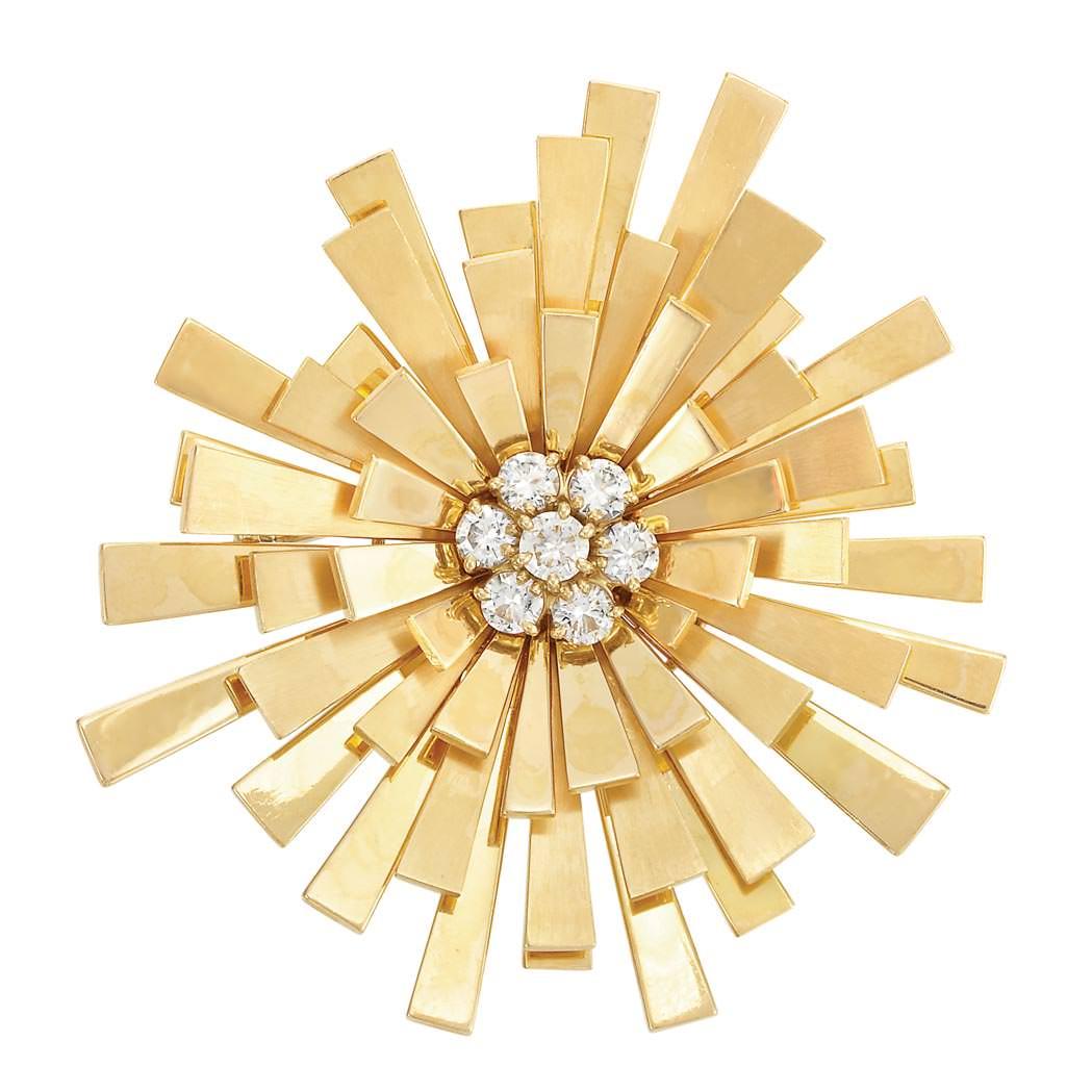 Broche Sunburst de Cartier en oro y diamantes - estimado entre $7.000 y $9.500