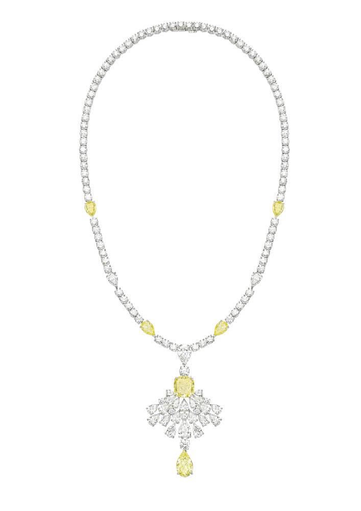Collar en oro blanco con diamantes amarillos y blancos