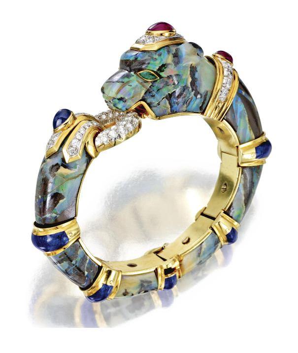 Brazalete pantera de David Webb en oro y platino con ópalo boulder, diamantes y esmalte