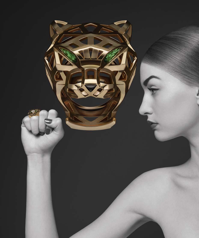 Anillo Cartier Panthère de la Colección Cartier 2014 con oro amarillo, ónice, tsavoritas y granates