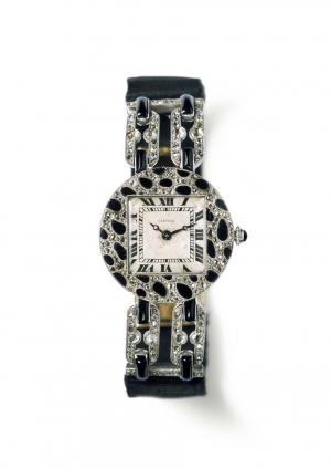 Reloj Cartier 1914 con motivos de piel de pantera, caja en platino y pavé de diamantes y ónice