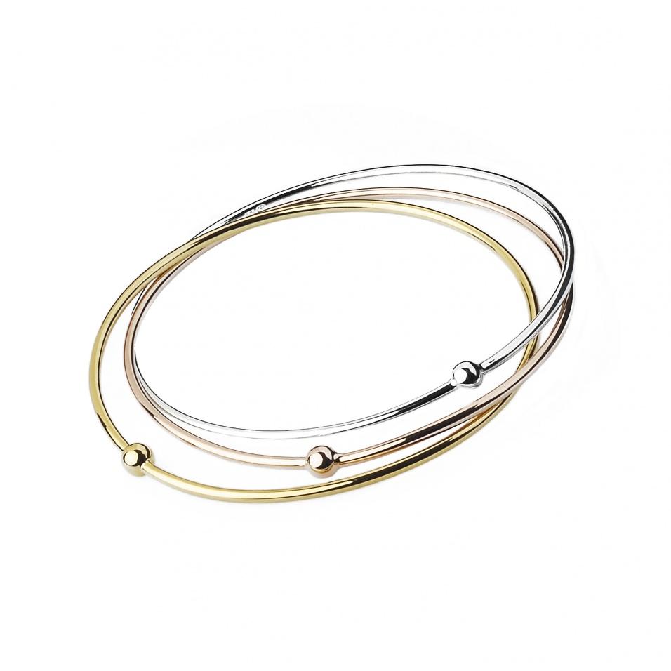 Pulsera Jonc Fin rígida con 3 aros entrelazados en tres colores de plata, baño de oro y oro rosa - precio de 115 euros