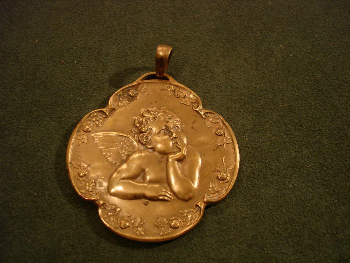 Medallón para cuna en bronce