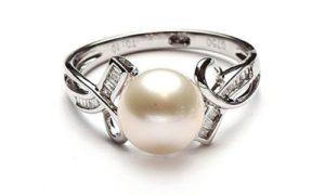 El solitario Perla y lazos baguette de Diamantisimo