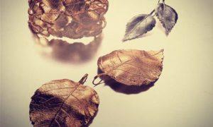 Joyas Aurélie Bidermann en hojas de otoño y espinas de rosas